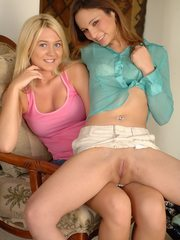 Two gorgeous lesbian teen babes spreading hot legs